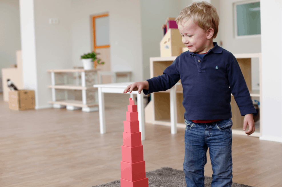 Toddler playing with the Best Toys For Children With Nonverbal Autism